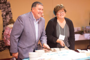 Danny Soucy, Executive Director, and Moira Wilson, President, cut the 60th Anniversary cake!