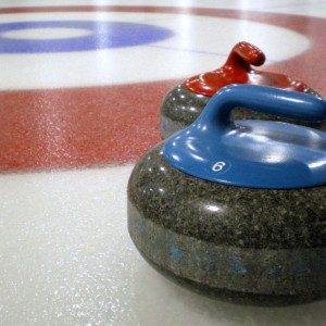Curling_stones_on_rink_with_visible_pebble